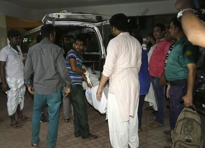 epa05277279 The bodies of the Bangladesh's first LGBT magazine editor and local USAID staff, Xulhaz Mannan and his friend Mahbub Tonoy are brought out from a building after police primary investigation at their house at Tetul Tala, Kalabagan, Dhaka, Bangladesh, 25 April 2016. According to police, several unidentified assailants hacked Mannan and his friend Tonoy to death in a flat around 5pm.  EPA/ABIR ABDULLAH